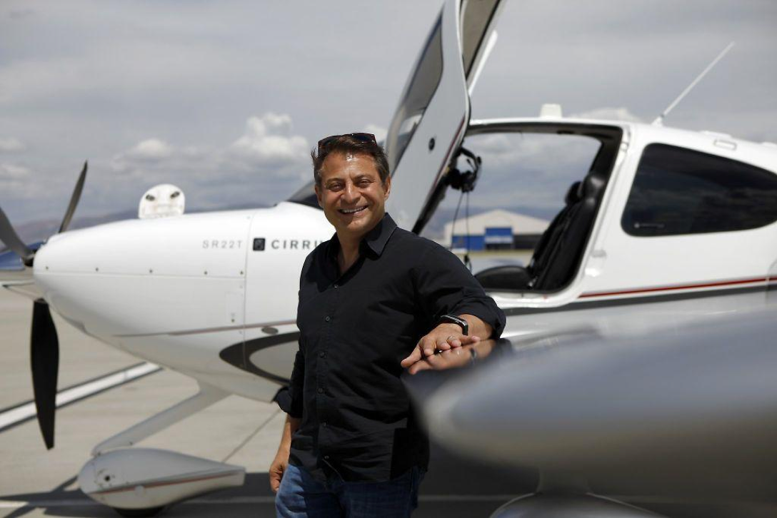 Peter Diamandis standing in front of a plane.